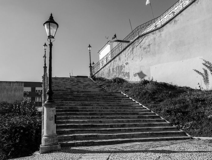 """they meet at these steps. she at bottom and he upon. Suddenly she begins levitating up, straight to him, without touching the steps. """"What is happening ?! she asks, to which he respond """" Rest Darling! is only my heart pulling you to me"""". Taking Photos Street Photography Monochrome Blackandwhite Photography Blackwhitephotography Youinlisbon Click Saudade"""
