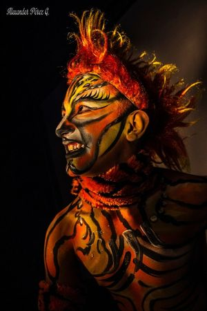 Actor Studio Shot Human Face Human Body Part Halloween One Person People Clown Close-up Gold Colored Artista Artistic Photo Bodypainting Bodyart Bodypainted Redhead Artistic Expression Black Background Mythology Portrait Indoors  Adult