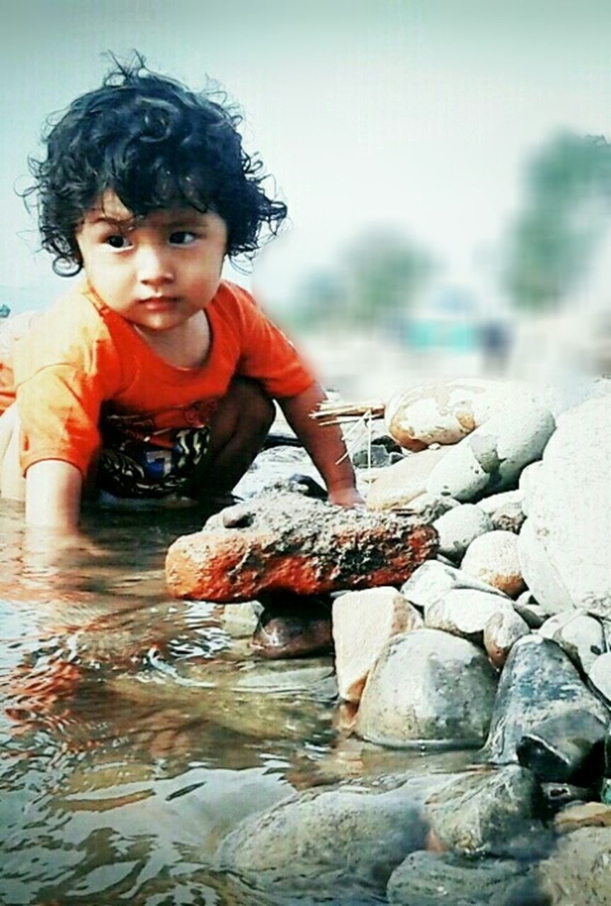 childhood, one person, portrait, looking at camera, front view, boys, water, child, one boy only, full length, day, smiling, outdoors, nature, children only, people