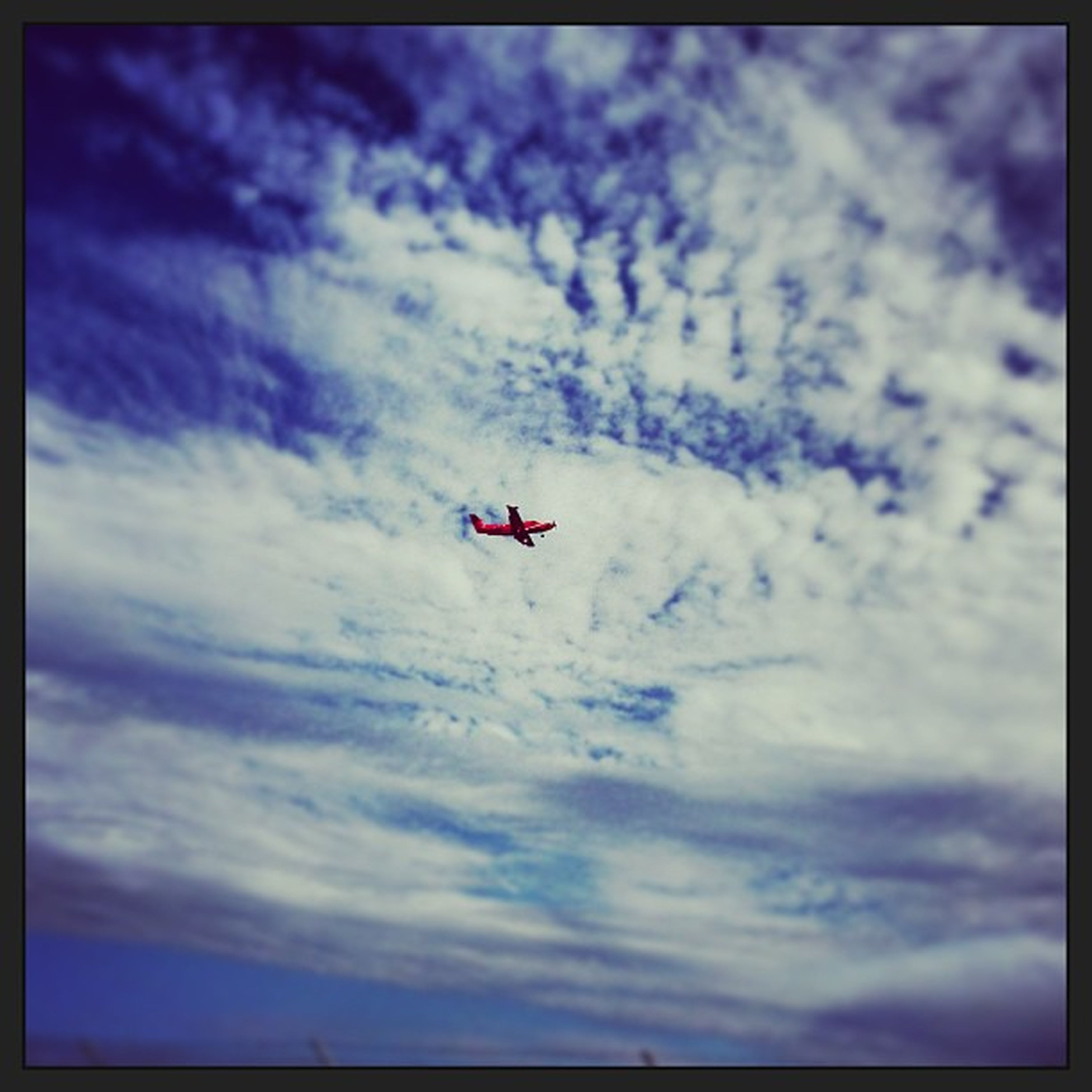 transportation, flying, mode of transport, air vehicle, airplane, mid-air, low angle view, sky, cloud - sky, cloudy, on the move, cloud, travel, journey, transfer print, day, helicopter, motion, auto post production filter, outdoors