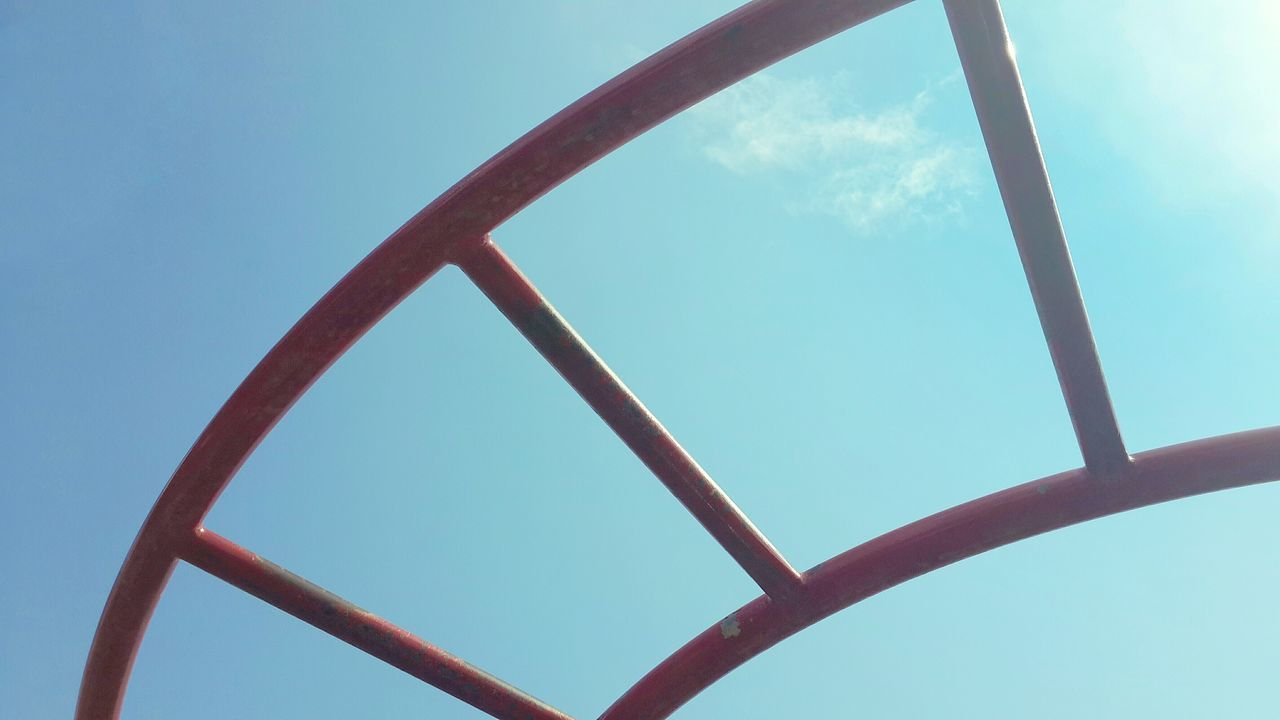 Low Angle View Of Metallic Ladder Against Sky
