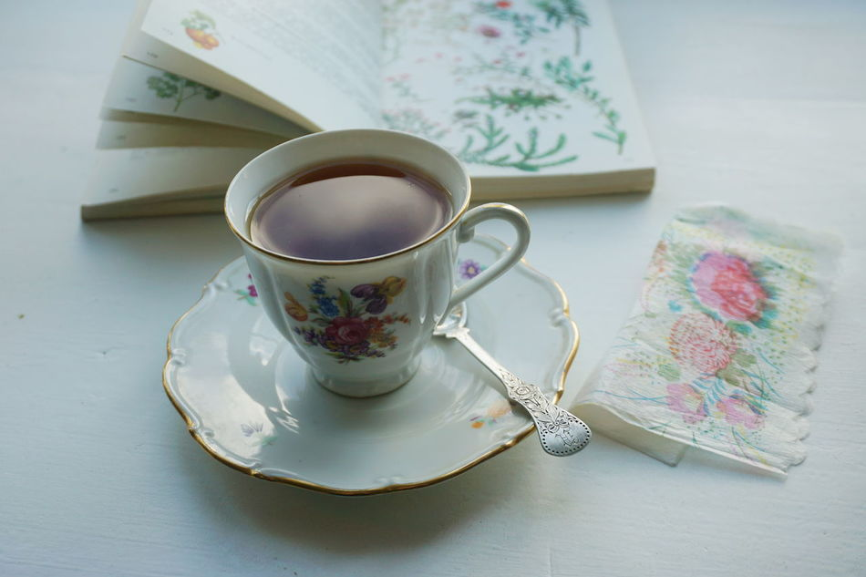 Tea time. The sky and the clouds are reflecting in the tea cup. Close-up Day Drink Food And Drink Freshness Hot Drink Hot Drinks Indoors  No People Old Fashioned Reading Refreshment Relaxing Saucer Table Tea Tea - Hot Drink Tea Time