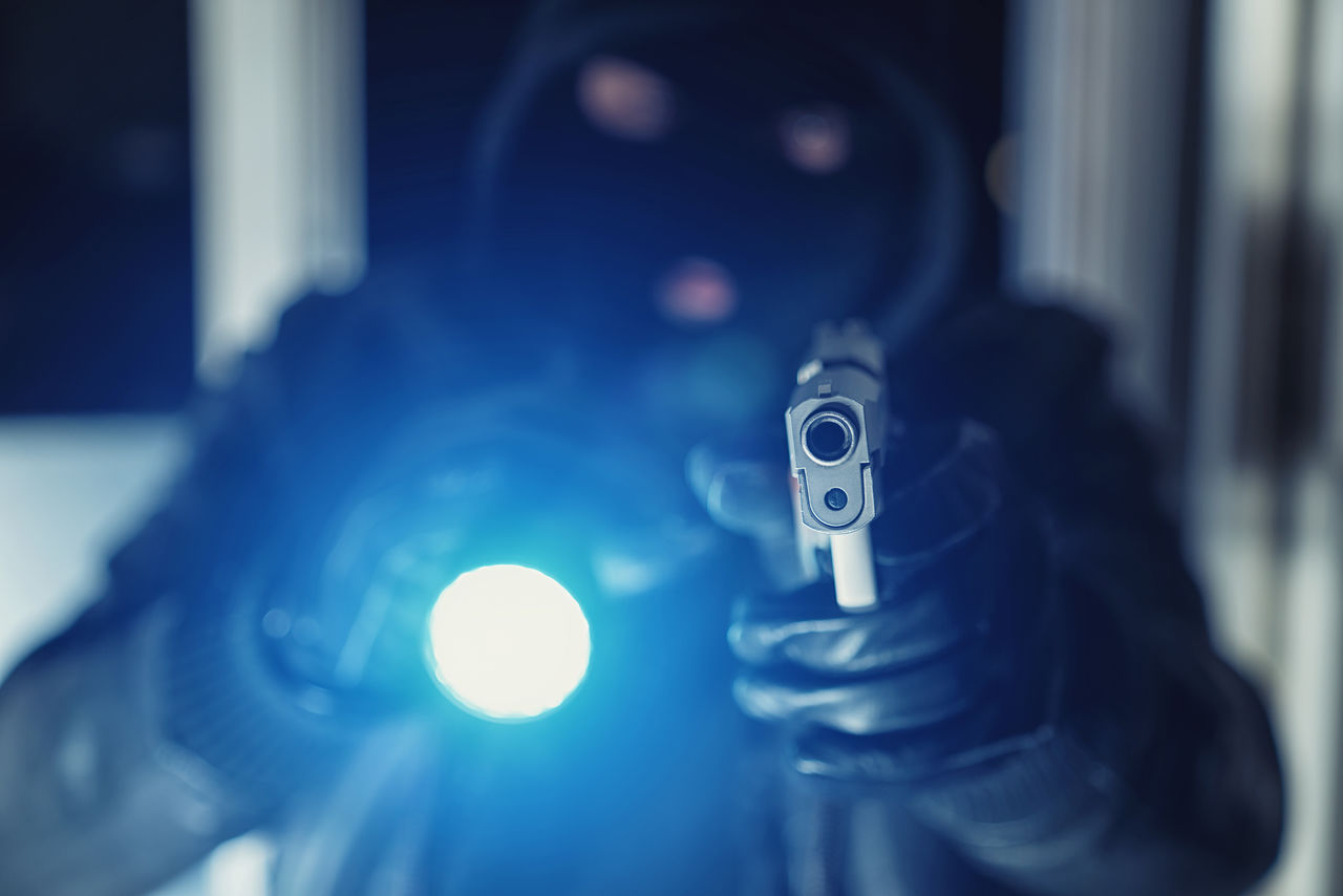 Criminial gangster holding weapon with flashlight Adult Breaking Crime Gun Theft Alarm Bank Burglar Burglary Criminal Flashlight Gangster Gloves Holding Hostage Indoors  Justice Mask One Person People Real People Robber Terror Terrorism Weapon