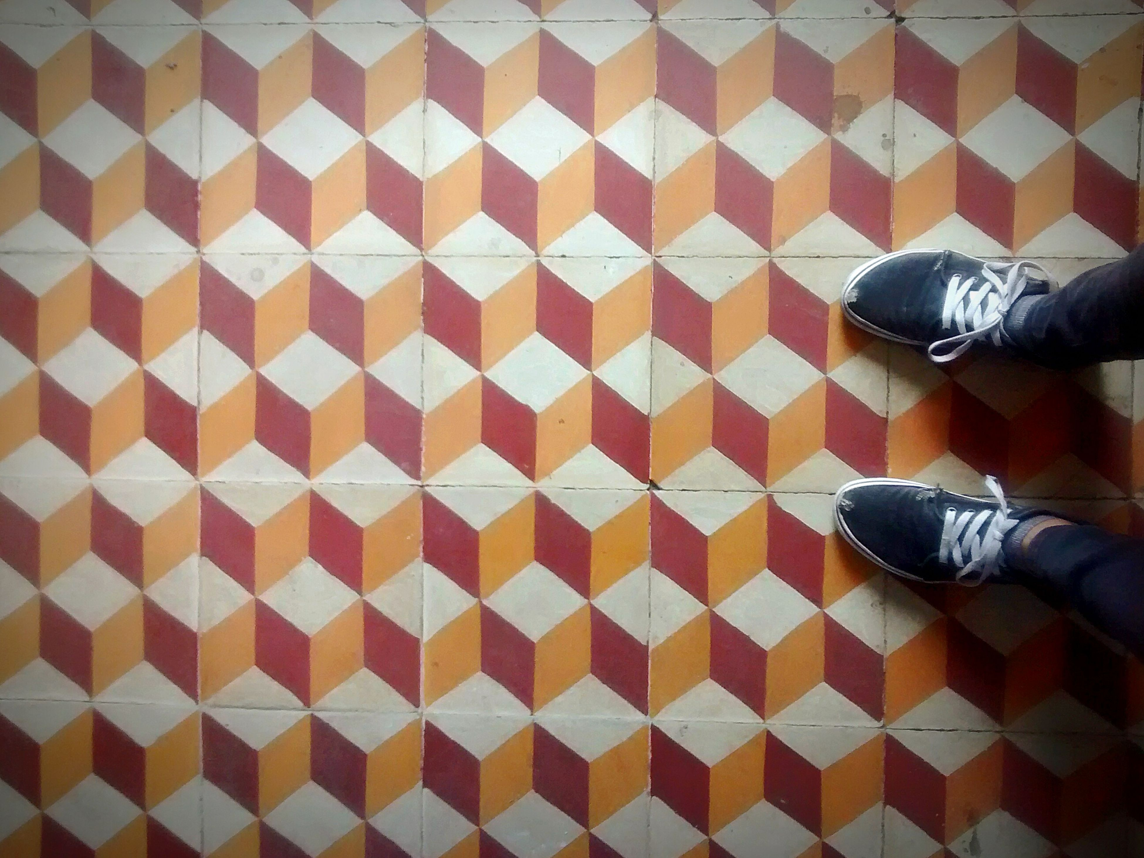 low section, person, shoe, lifestyles, standing, human foot, footwear, personal perspective, unrecognizable person, leisure activity, part of, flooring, tile, canvas shoe, casual clothing, day, close-up