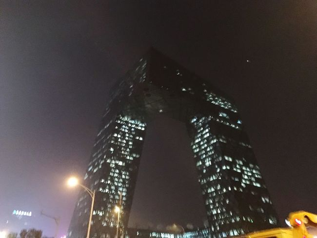 Architecture Rem Koolhaas Beijing, China Illuminated Architecture Low Angle View Built Structure Building Exterior City Skyscraper Modern Night Tower Tall - High Street Light Sky Office Building City Life Outdoors High Section Dark Development Building Story
