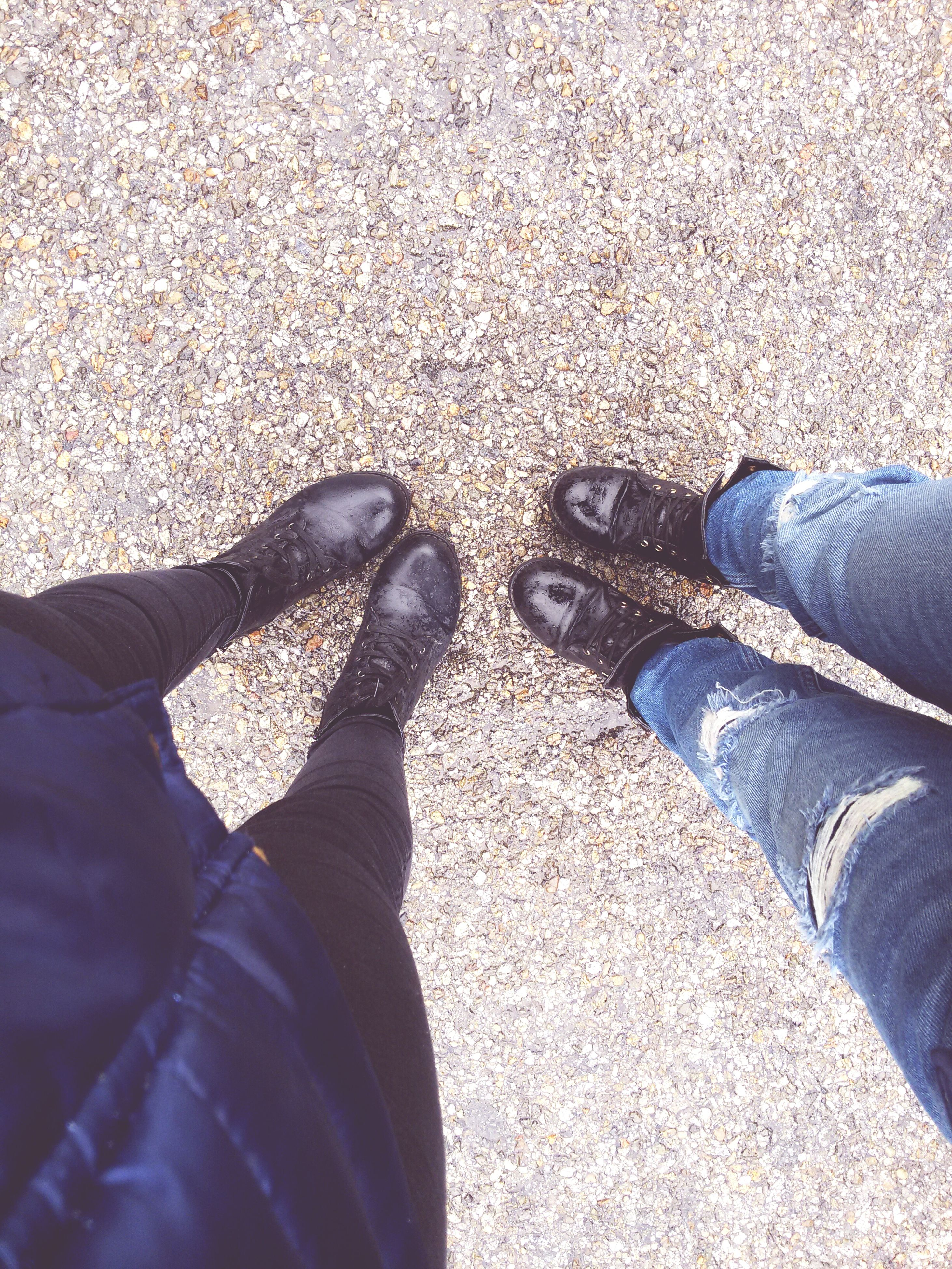 low section, person, shoe, personal perspective, lifestyles, human foot, standing, jeans, footwear, men, high angle view, leisure activity, unrecognizable person, street, casual clothing, directly above