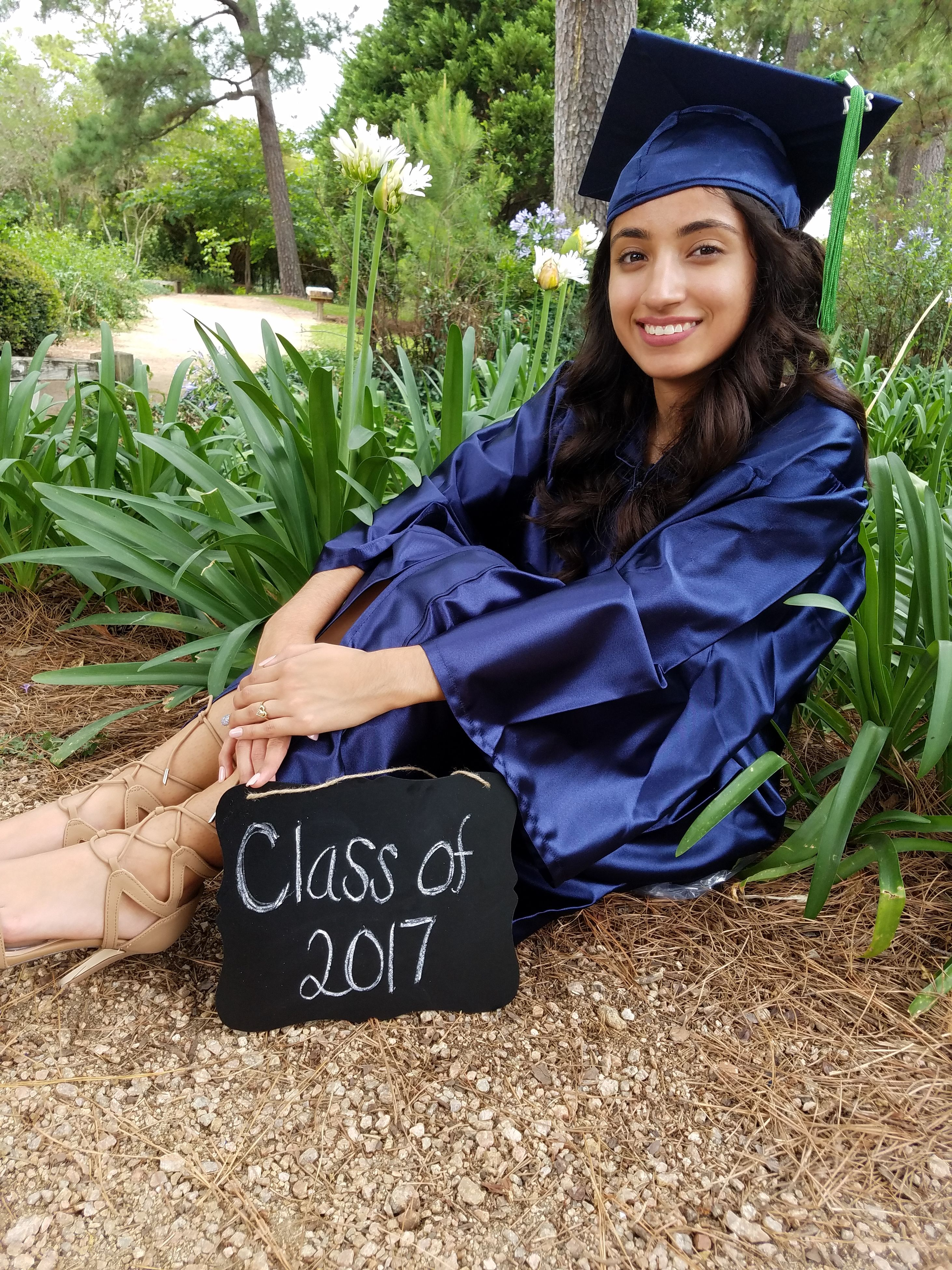 mortarboard, graduation, achievement, real people, looking at camera, one person, happiness, smiling, education, lifestyles, portrait, young adult, young women, outdoors, cheerful, day, people