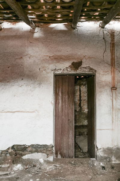 Abandoned Animal Themes Architecture Bad Condition Built Structure Closed Damaged Day Deterioration Door House Indoors  Messy No People Obsolete Old Run-down Shadow Weathered Window Wood - Material