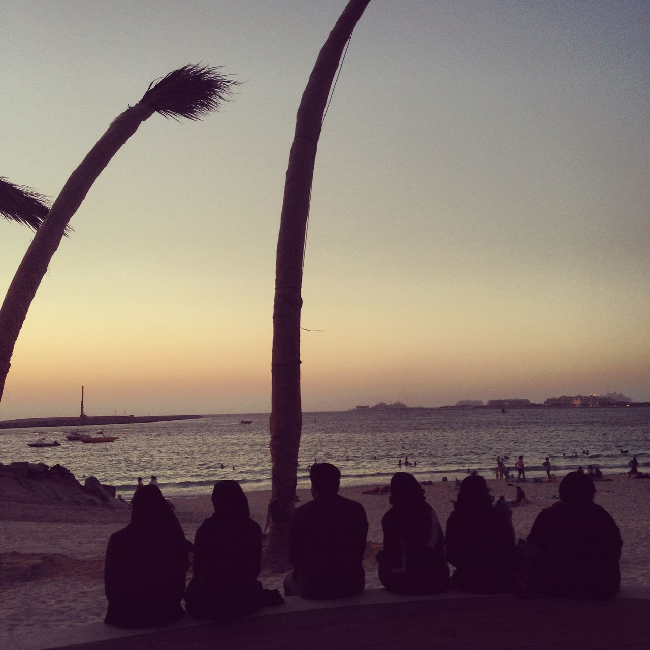 silhouette, sunset, sea, beauty in nature, water, sky, nature, beach, horizon over water, scenics, tranquil scene, men, tranquility, clear sky, relaxation, outdoors, real people, tree, day, people