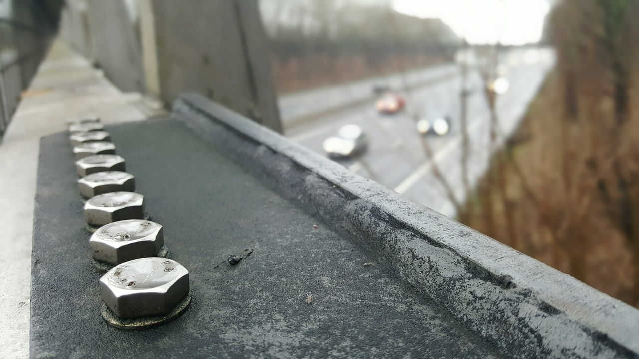 Uk motorway view metal fence bolts Day No People Outdoors Close-up Background Speed Fast Trucks Lorry Motorway View Motorway Uk Geometry Bolts Fence Safety Border Transportation Authentic