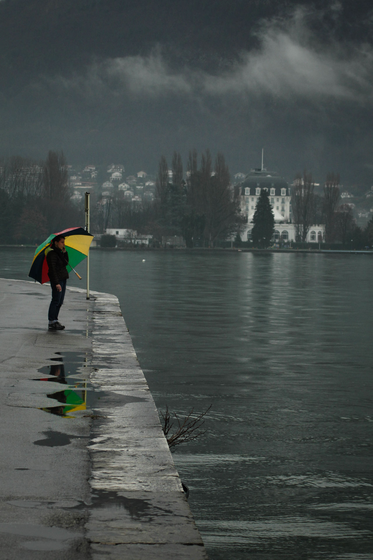 Weather-Worn Adult Annecy Cloud - Sky Outdoors People Quiet Moments Rainy Rainy Days Reflection Standing Tranquility Umbrella Water Weather Miles Away EyeEmNewHere Candid Candid Photography France Woman Serene Outdoors Overcast Tranquil Scene Rainy Weather Overcast Skies