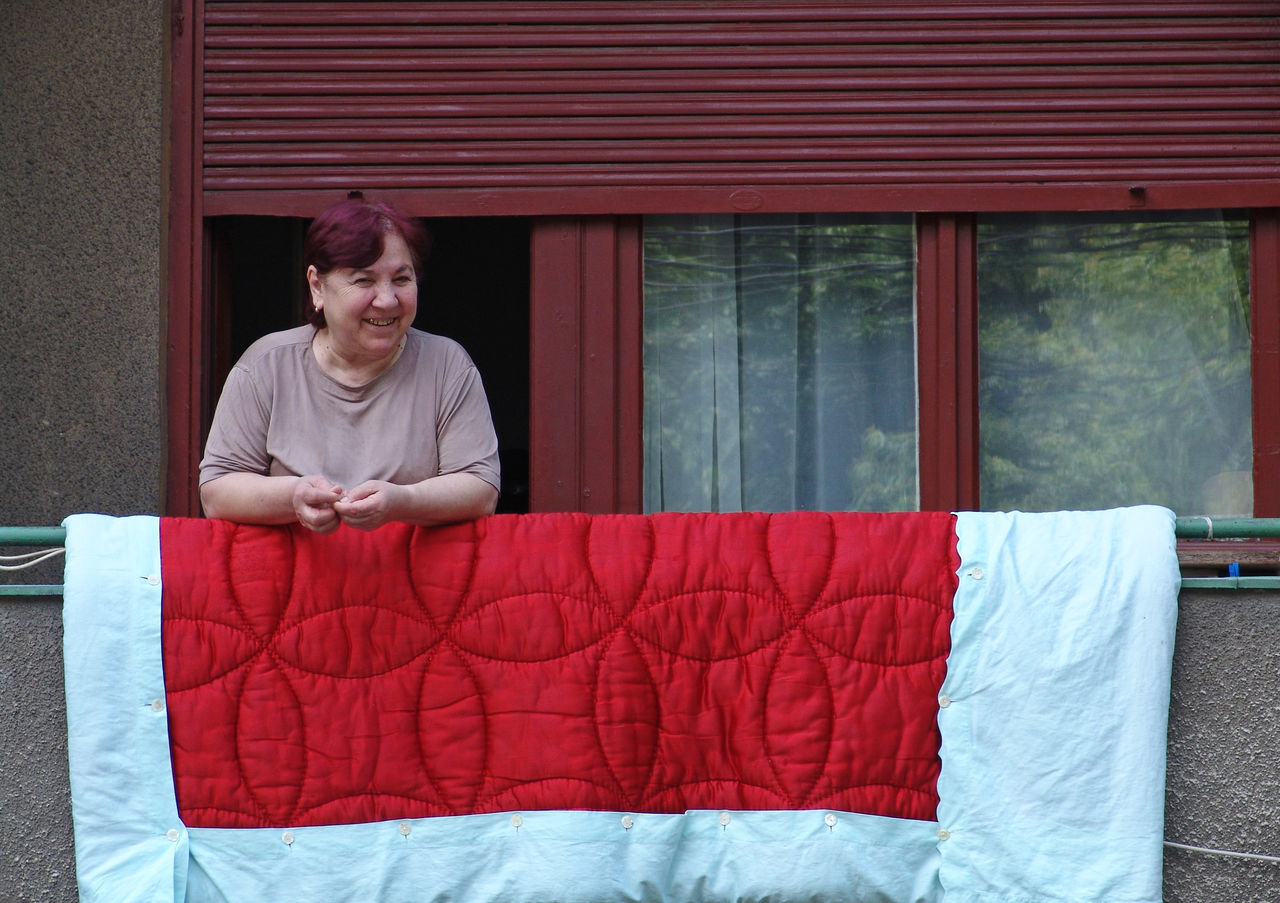 Friendly neighbour Balcony Blanket Bucharest Day Friendly Laundry Leisure Activity Lifestyles Mature Neighbor Neighborhood Old Portrait Red Romania Romanian  Senior Smiling Woman Everyday Emotion People And Places