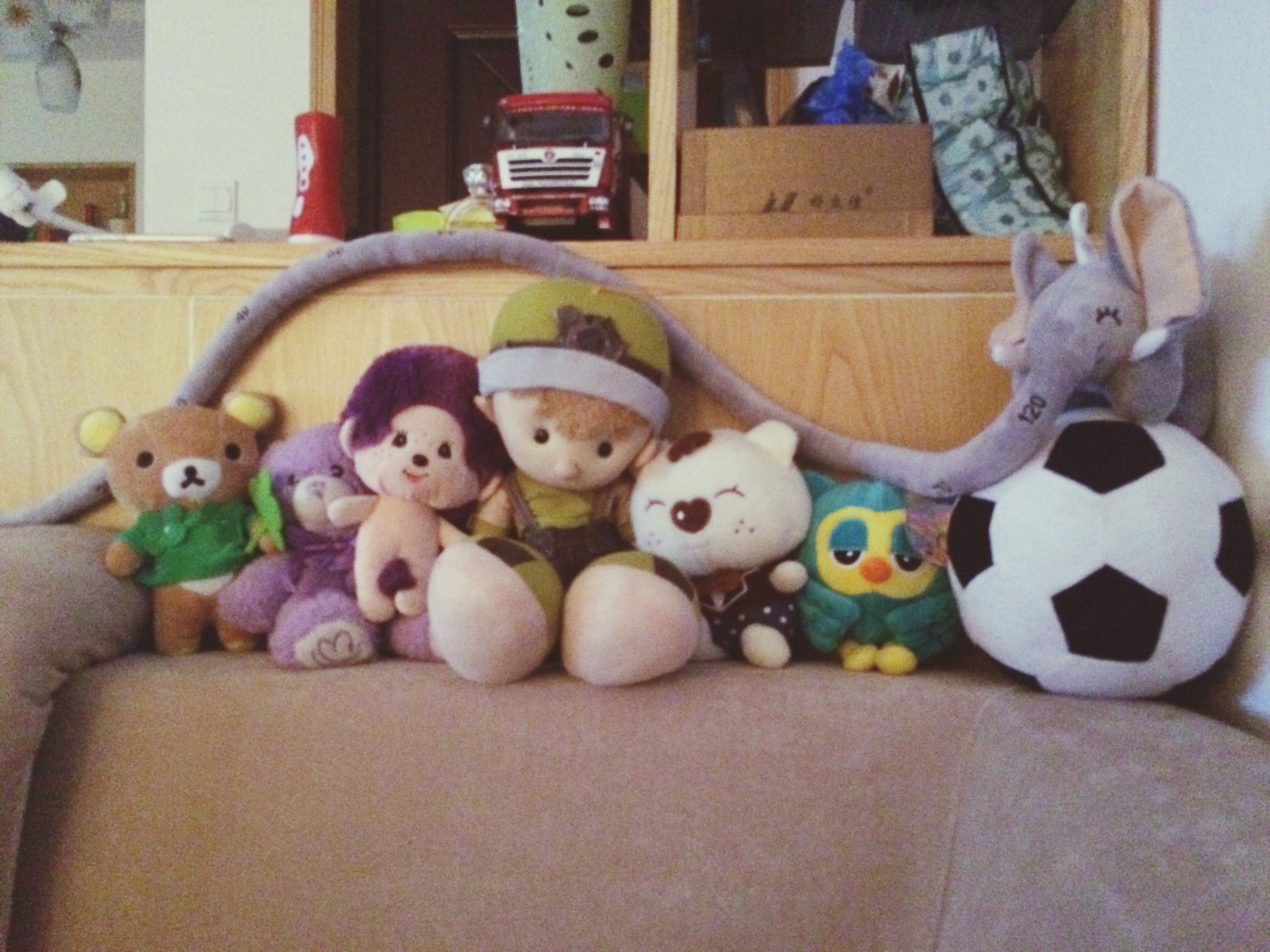 toy, domestic animals, animal representation, multi colored, indoors, childhood, stuffed toy, art and craft, pets, animal themes, art, variation, human representation, creativity, dog, two animals, ball, one person, teddy bear, street