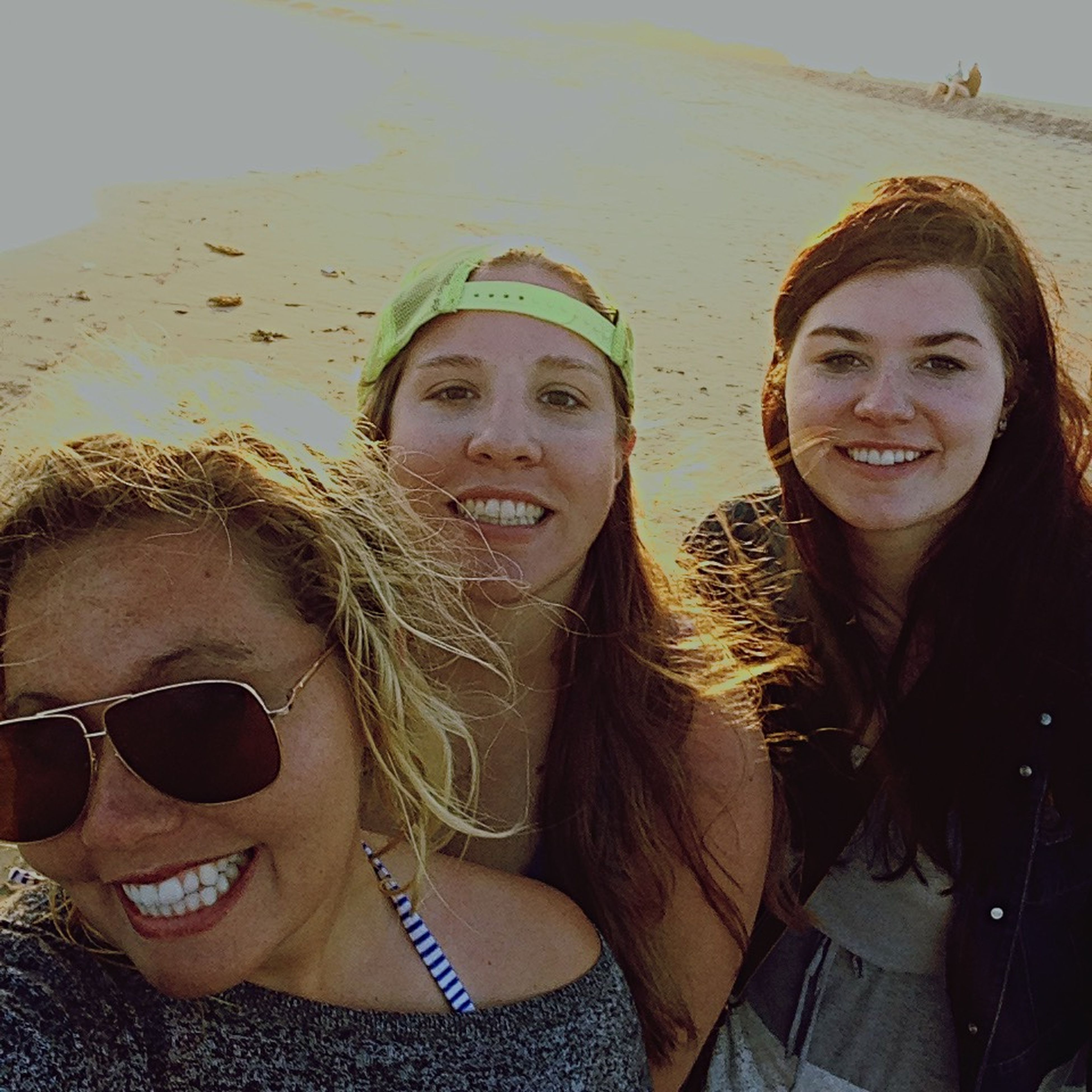 looking at camera, portrait, person, lifestyles, young adult, leisure activity, smiling, young women, front view, happiness, sunglasses, togetherness, headshot, bonding, toothy smile, casual clothing