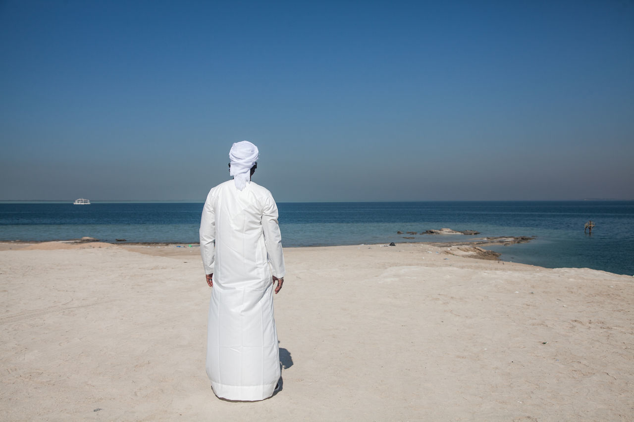 Adult Adults Only Arab Arab Man Beach Beauty In Nature Clear Sky Day Emirati Emirati Arabi Horizon Over Water Nature One Person Outdoors People Rear View Sand Sea Sky Standing Uae,abudhabi Vacations Water