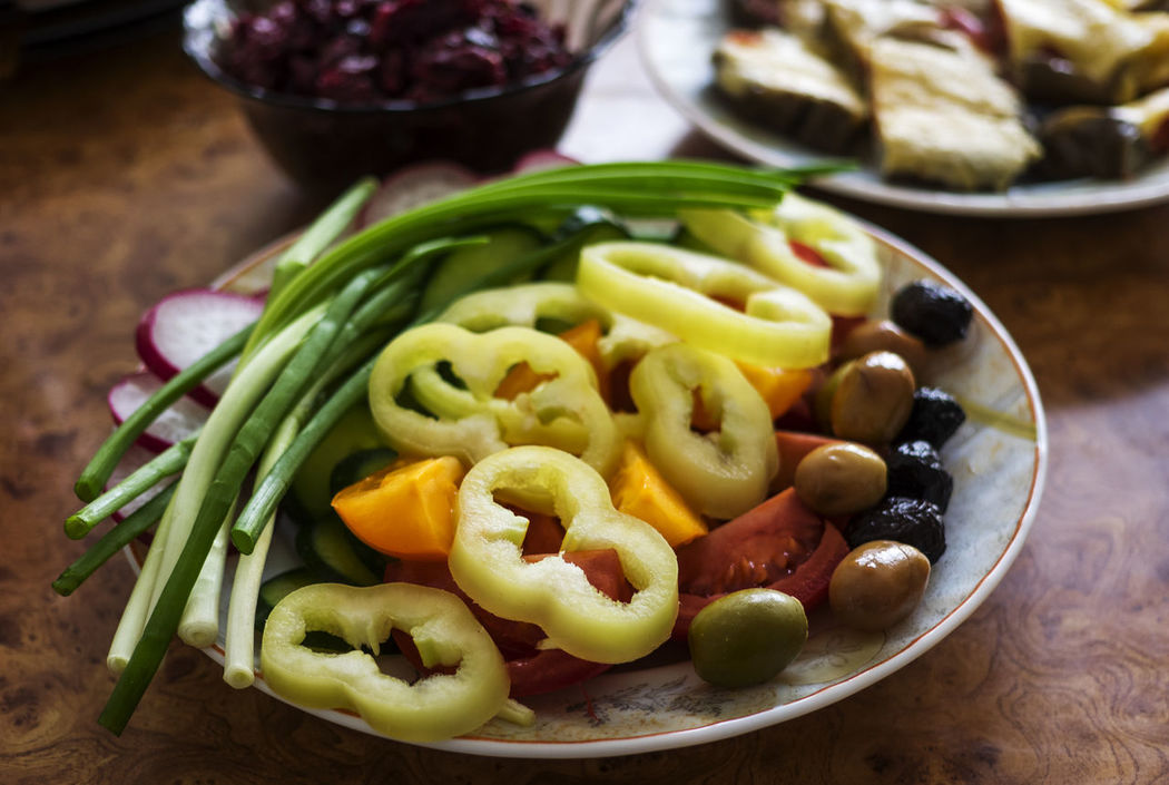 Fresh Vegetables Plate. Selective focus Bell Cucmber Fresh Green Olivas Onion Pepper Plate Selective Focus Tomatoes Vegetables