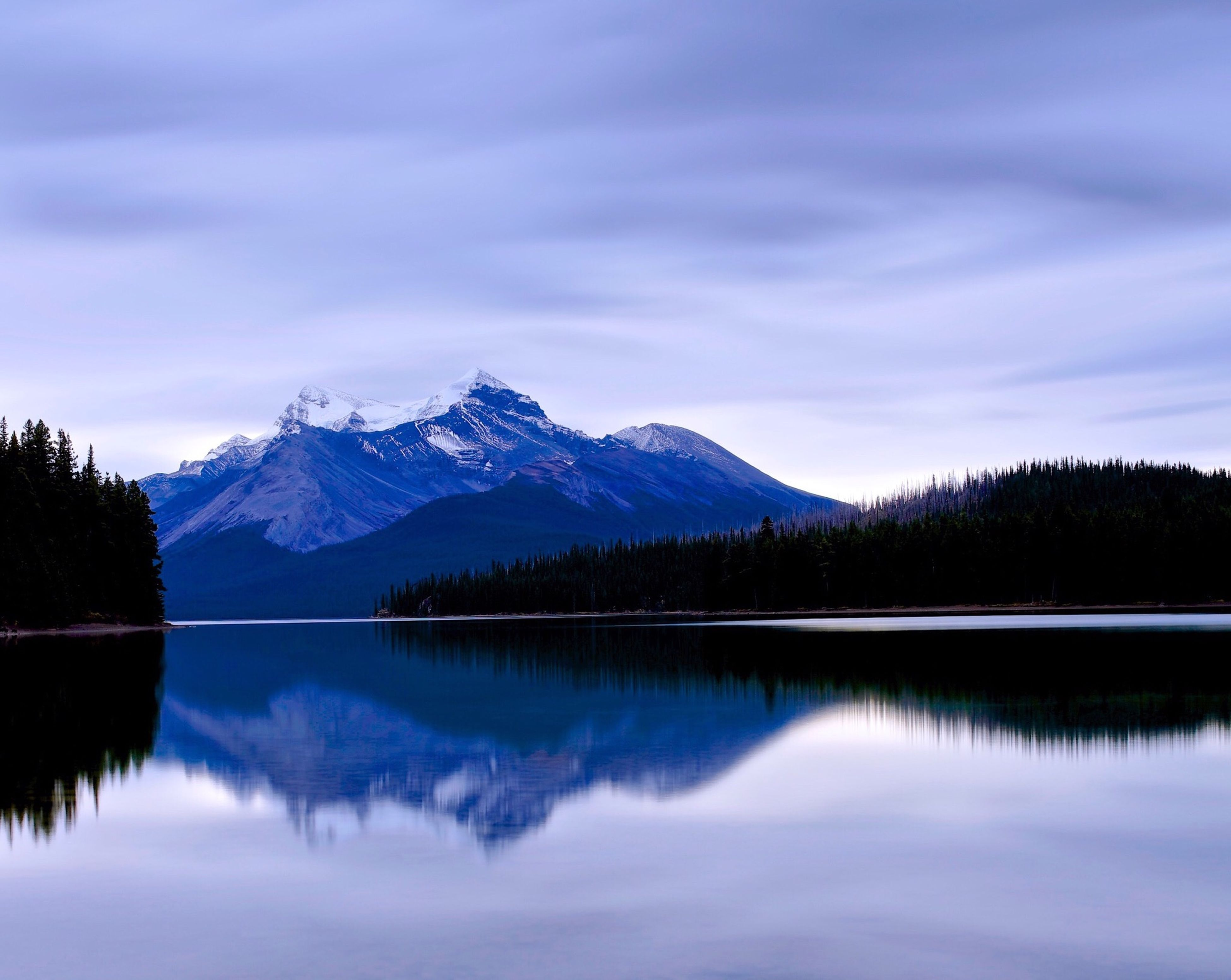 mountain, lake, tranquil scene, reflection, mountain range, tranquility, scenics, water, beauty in nature, waterfront, winter, snow, cold temperature, sky, snowcapped mountain, nature, cloud - sky, idyllic, tree, majestic