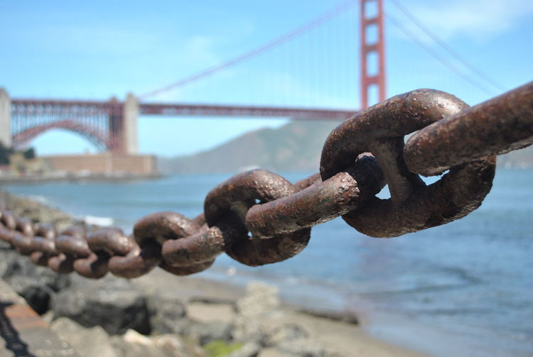 Strong Bond Bond Iron San Francisco Architecture Bridge Bridge - Man Made Structure Built Structure Chain Bridge Connection Day Engineering No People Outdoors Sky Strength Strong Connection With Water Transportation Water