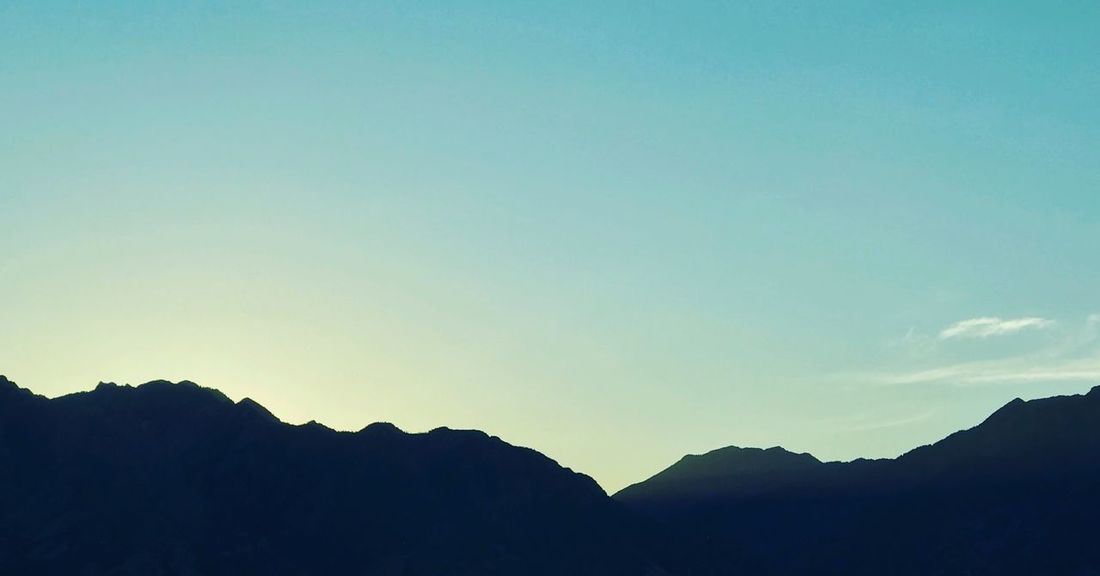 Silhouette Nature Mountain Tranquility Tranquil Scene Beauty In Nature Scenics No People Outdoors Day Low Angle View Clear Sky Sky