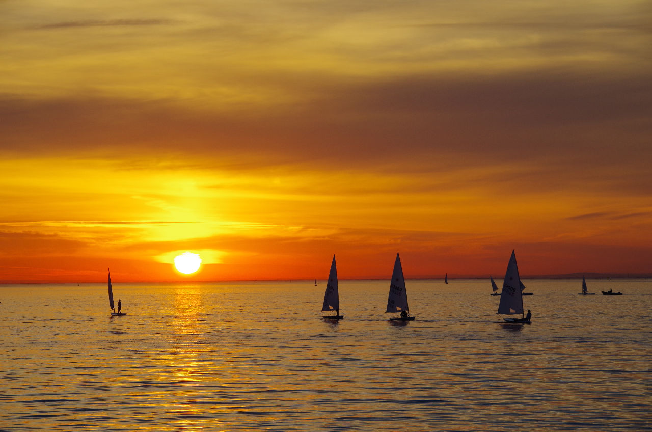 sunset, sea, orange color, beauty in nature, water, scenics, nature, silhouette, sky, cloud - sky, sun, tranquil scene, nautical vessel, tranquility, horizon over water, transportation, waterfront, outdoors, no people, day