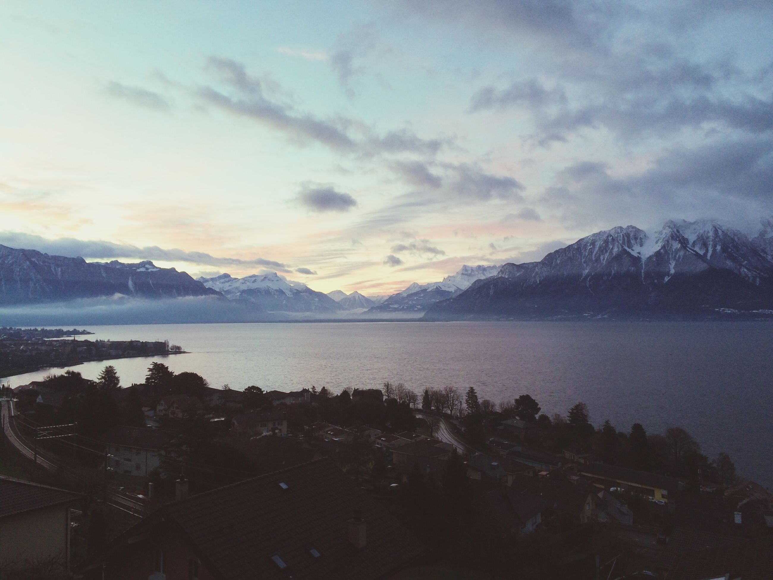 mountain, mountain range, scenics, tranquil scene, sky, water, tranquility, beauty in nature, lake, cloud - sky, nature, winter, idyllic, landscape, weather, cold temperature, cloudy, snow, cloud, non-urban scene