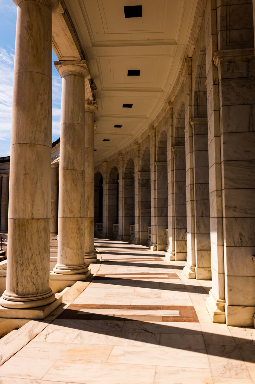 architectural column, architecture, history, built structure, sunlight, in a row, corridor, ancient, indoors, travel destinations, pillar, ancient civilization, no people, shadow, day