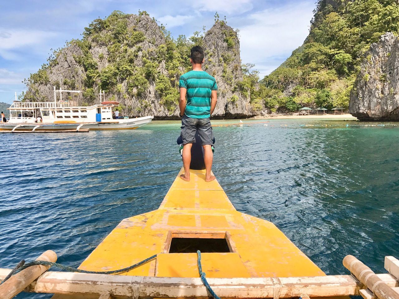 Our guide took us to a great spot. Rear View Man Captain Adventure Island Vacation South East Asia Lagoon Navigate Ahead In Front Forward One Person Full Length Sail Outdoors Sky Nautical Vessel Outrigger Vacation People Adult Adults Only Day Nature