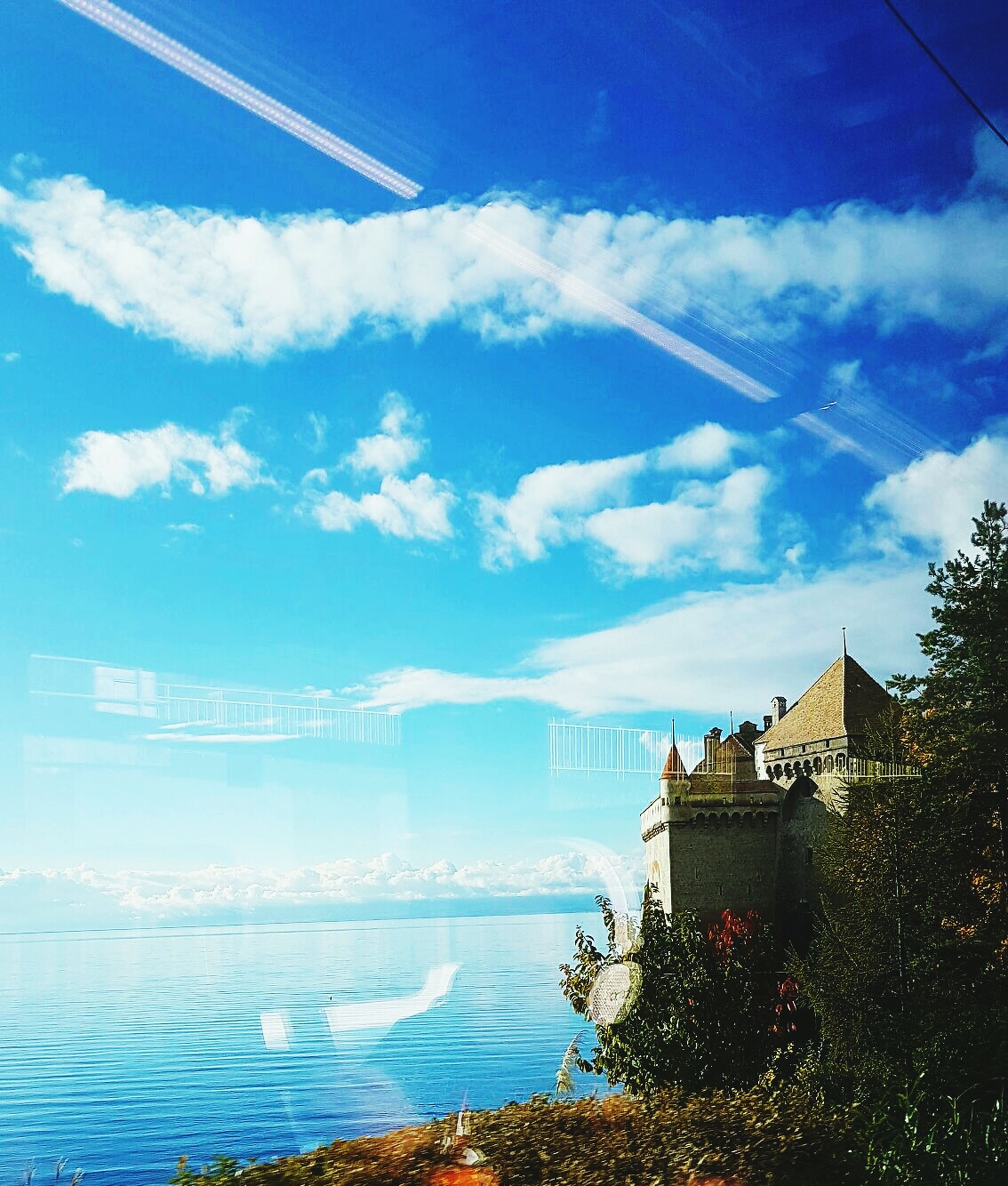 sky, blue, building exterior, cloud - sky, built structure, architecture, water, sea, outdoors, city, nature, no people, day, scenics, urban skyline, beauty in nature, skyscraper, beach, tree, cityscape, yacht