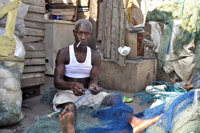 Fisherman repairing his Net Cigarette  Elderly Fisherman Fisherman´s Life Fishing Net Garbage Ghana Ghanaian Hut Man Net Outdoors Portrait Repairing Rubbish Sitting Smoking Working