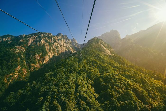 Yuping cable car on the way to the peak of Huangshan in Anhui Province, China Beauty In Nature Illuminated Outdoors Refraction Nature Sunrise And Clouds Mountain Peak Huangshan Mountains Cable Car View Ropeway Adventure Time Solo Traveler Heights Mother Nature Is Amazing EyeEm Best Shots - Nature Transportation System Sunlight Peak Of Mountain Aerial View Amazing Place Trail Hiking Adventures Top Perspective Fear Of Heights Flying High