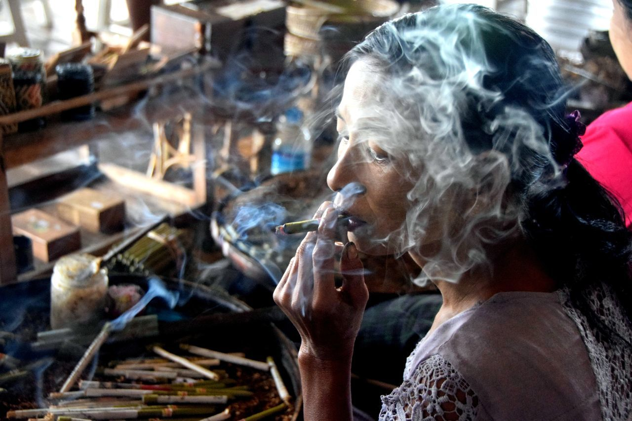 smoke - physical structure, smoking issues, real people, one person, bad habit, smoking - activity, headshot, addiction, focus on foreground, indoors, men, workshop, day, close-up, adult, people, adults only