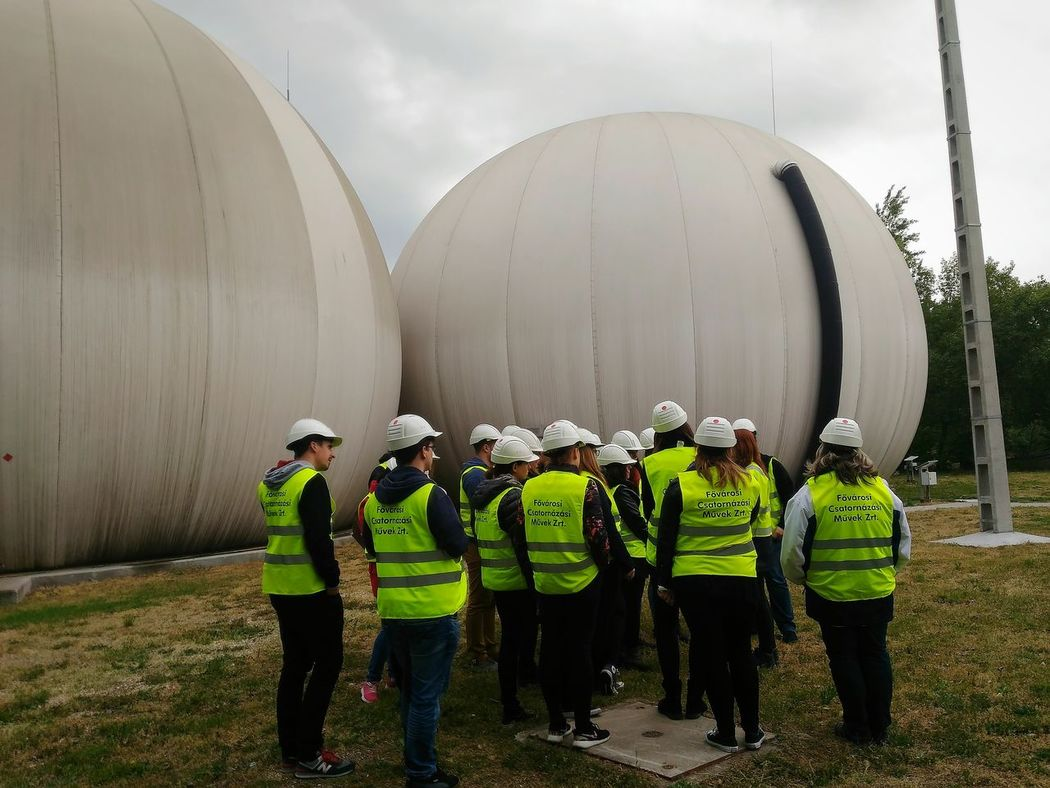 Biogas Biogas Methane Biofuel Mud Marsh Big Ballon Ballon Engineering Engineers Bioengineering Working Working Hard Green Vest Green Jacket Group Coop Driving Around Work Clothes Sewage Worker Vest Sewage Cleaning