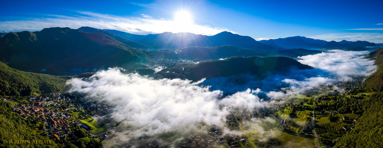 Mountain Blue Scenics Idyllic Beauty In Nature Sea Nature Tranquility Mountain Range Non-urban Scene Lens Flare Day Sunbeam Majestic Geology Remote Calm Outdoors Tranquil Scene Aerial View Panoramic No People Clouds Fog