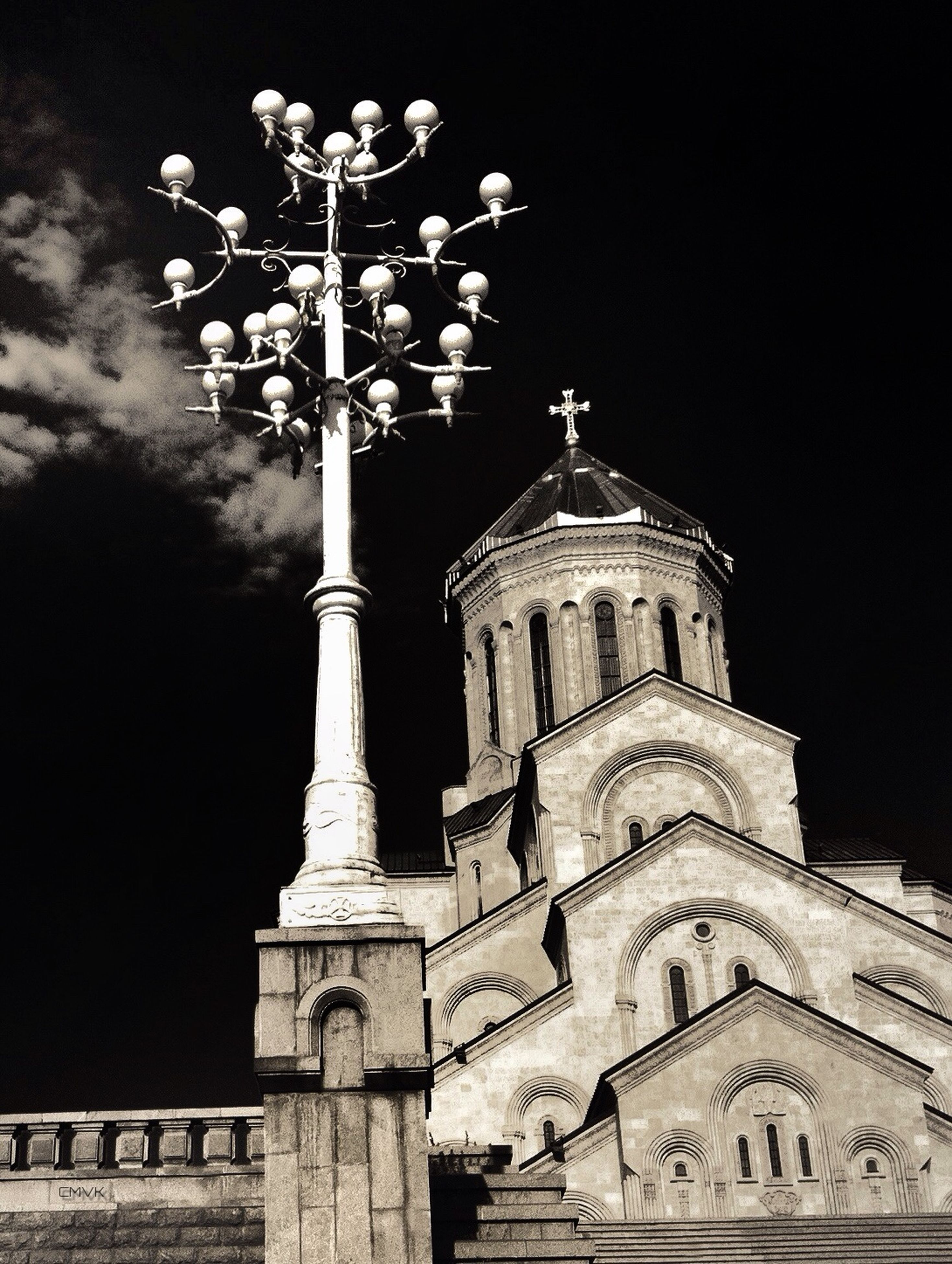 architecture, built structure, low angle view, building exterior, tree, night, religion, history, sky, place of worship, spirituality, clear sky, outdoors, old, travel destinations, street light, famous place, no people, architectural column