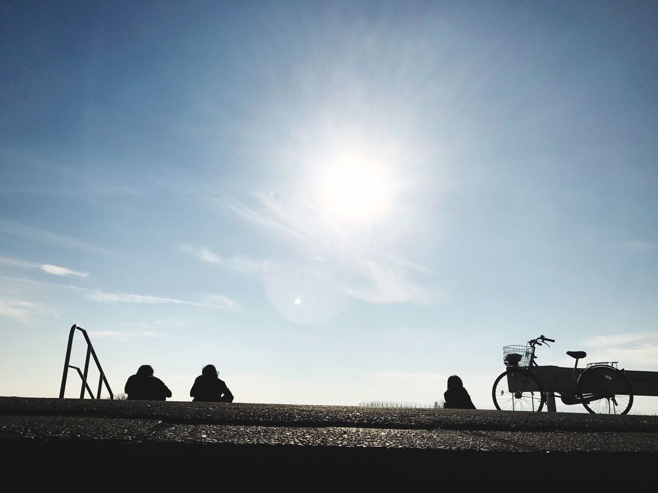 sky, domestic animals, field, men, sunlight, real people, sun, outdoors, silhouette, day, mammal, landscape, sitting, nature, occupation, one person, people