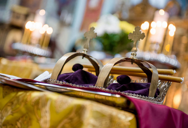 Golden crowns in orthodox wedding ceremony Church Engagement Golden Latvia Marriage Ceremony Orthodox Church Relationship Tradition Wedding Worship Accessory Attribute Candlelight Close-up Golden Crown Indoors  Marriage  No People Orthodox Cathedral Religion Religious  Riga Latvia Traditional Wedding Ceremony