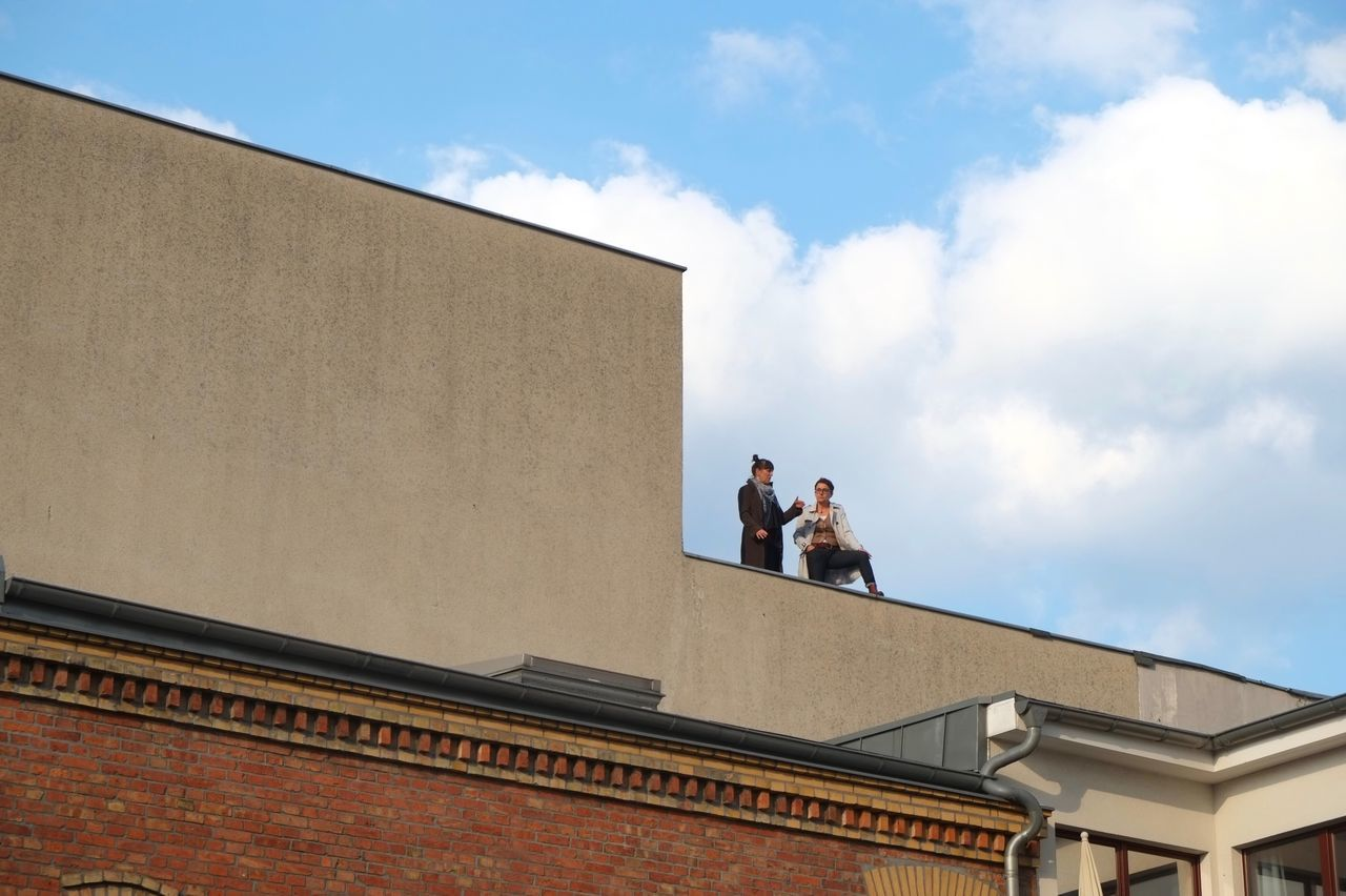 Smoke break. Rooftop Smoking Chatting Urban Architecture Lines Berlin Prenzlauerberg