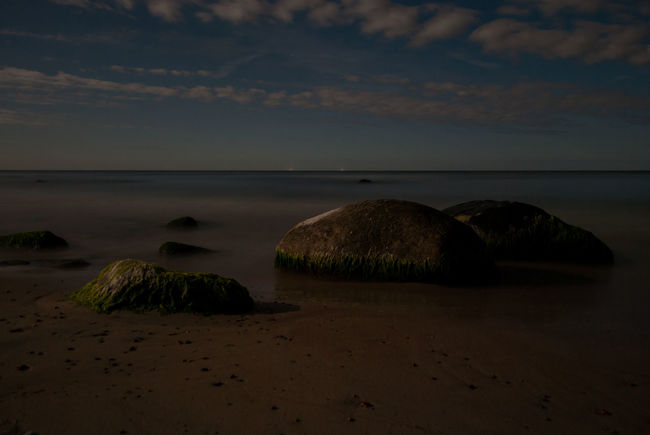 A picture of a sea at night in a MOONSHINE, I was amazed of the light coming from the sky, Moon, but I was more amazed of my camera. Autumn Baltic Sea Beach Beauty In Nature Calm Cloud Cloud - Sky Coastline Day Horizon Over Water Idyllic Lithuania Moss Nature Nature Ocean Outdoors Sand Sea September 2016 Shore Sky Stone Tranquility Water