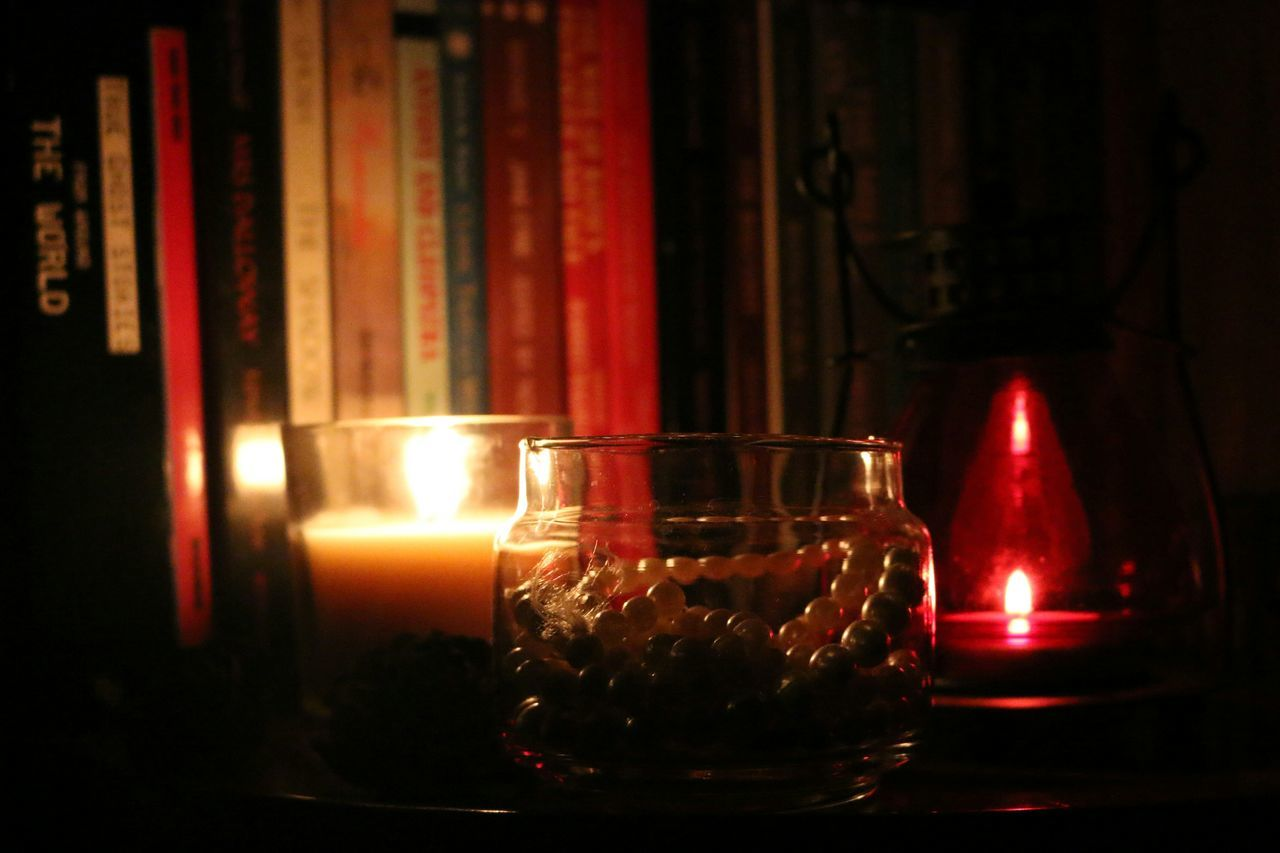 Books, candle light, lamps and pearls~ elegant at it's peak! Glass - Material Indoors  Dark Close-up Flame Check This Out Flameshots Pearlsofwisdom Pearls Candlelight Candle Holder Lamps And Lighting Shadows & Lights Back Lightning Books Bookshelf Aromatherapy Scented Candle Elégance Tranquility Time To Relax Light Show PearlsAreBeautiful No People Closeup Photography