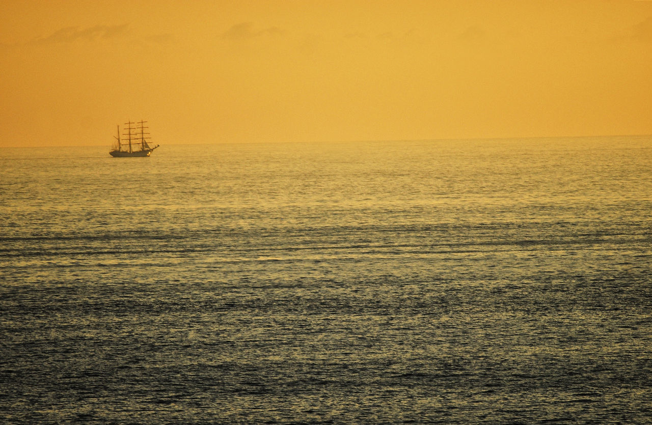Beauty In Nature Boat Day Gold Lights Horizon Over Water Nature Nautical Vessel No People Offshore Platform Outdoors Refraction Scenics Sea Sunset Tranquil Scene Water Waves Yellow Light The Great Outdoors - 2017 EyeEm Awards Breathing Space
