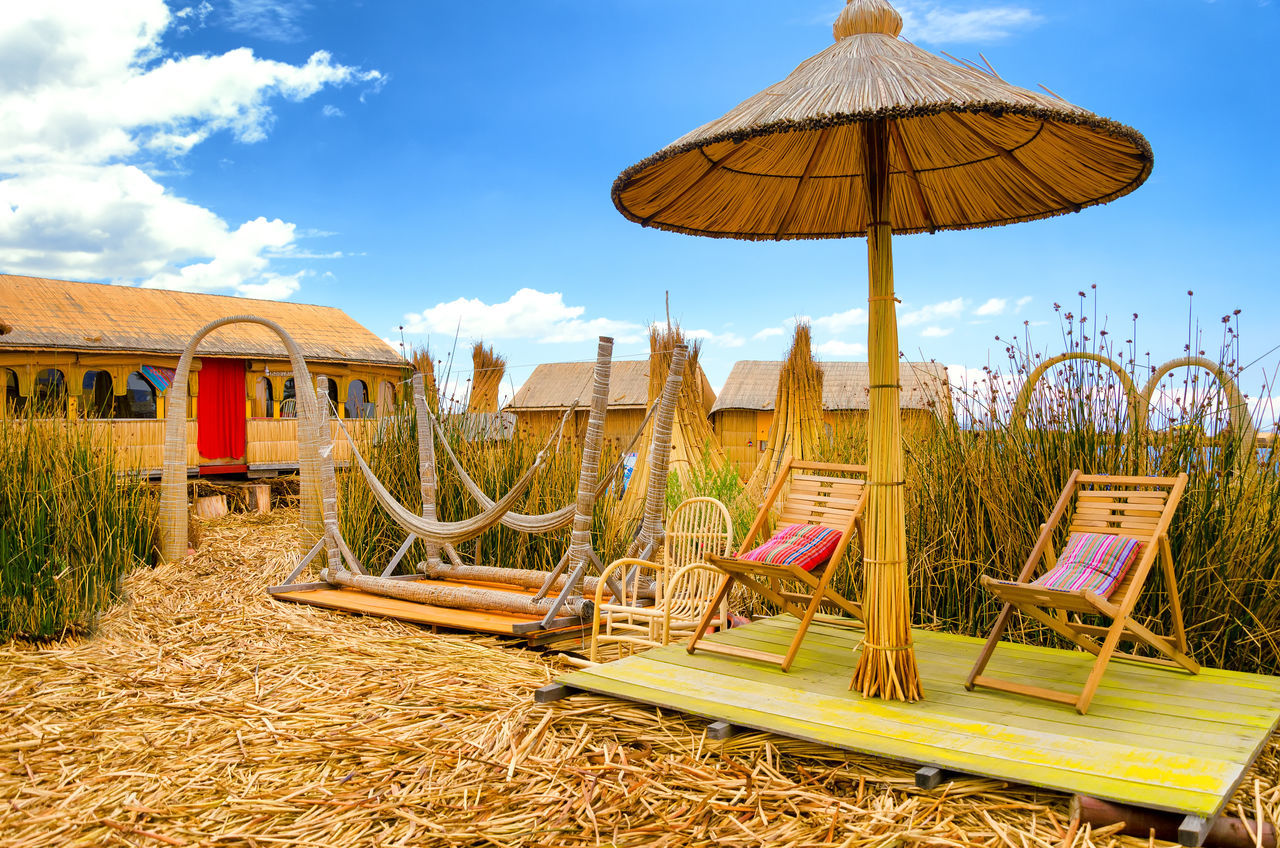 Chairs and hammocks on a man made floating island on Lake Titicaca in Peru America Architecture Building Exterior Chair Destination Floating Hammock House Indian Indigenous  Island Lake Outdoors Peru Puno Scenic South Titicaca Titicaca Lake Totora Tourist Traditional Uros Uros Island Village
