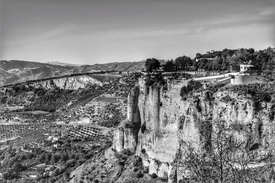 Looking Down Near The Edge Distant Mountains Cliff Edge Cliff View Cliff Face Scenic Landscapes Ronda Ronda Spain Ronda, Malaga Ronda Andalucia Andalucian Town High Angle View Clifftop Black & White Photography Black & White Blackandwhite Photography Black And White Photography Black And White Scenics Landscape Mountain Cliffside Cliffs Cliff
