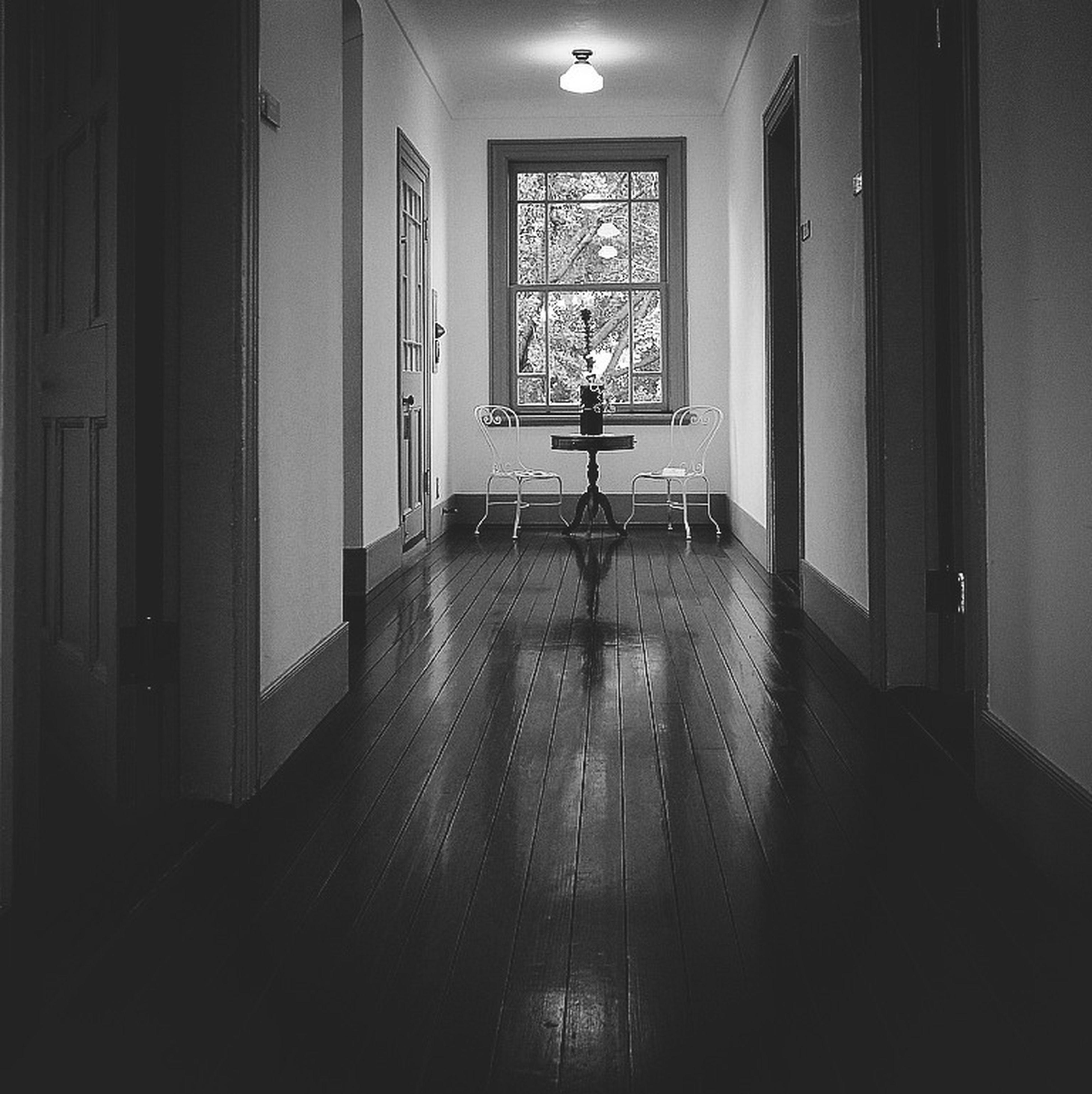 indoors, corridor, window, flooring, architecture, home interior, door, built structure, empty, absence, ceiling, interior, the way forward, domestic room, house, doorway, no people, tiled floor, room, sunlight
