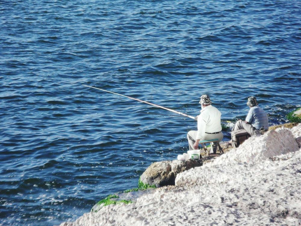 Alexanderia Egypt Fishing Real People Sea Fishing Pole Standing Water Men Outdoors Nature Day Occupation Two People Full Length Fisherman Fishing Tackle Beauty In Nature Horizon Over Water Working People The Portraitist - 2017 EyeEm Awards