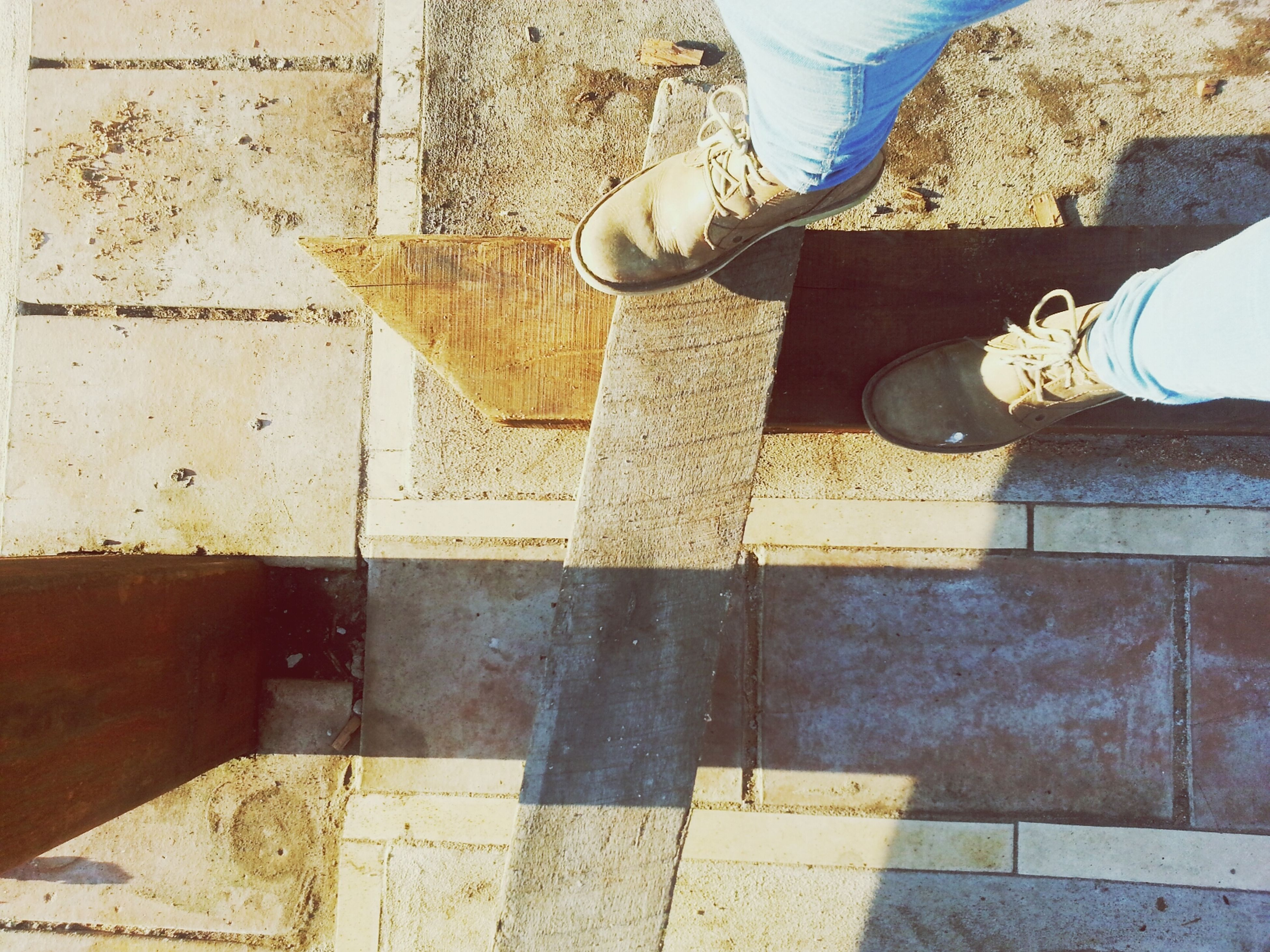 low section, person, shoe, men, standing, lifestyles, human foot, footwear, high angle view, paving stone, leisure activity, tiled floor, cobblestone, architecture, day, built structure