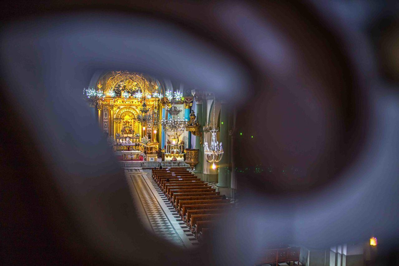 focus on background, religion, illuminated, indoors, spirituality, place of worship, architecture, no people, day