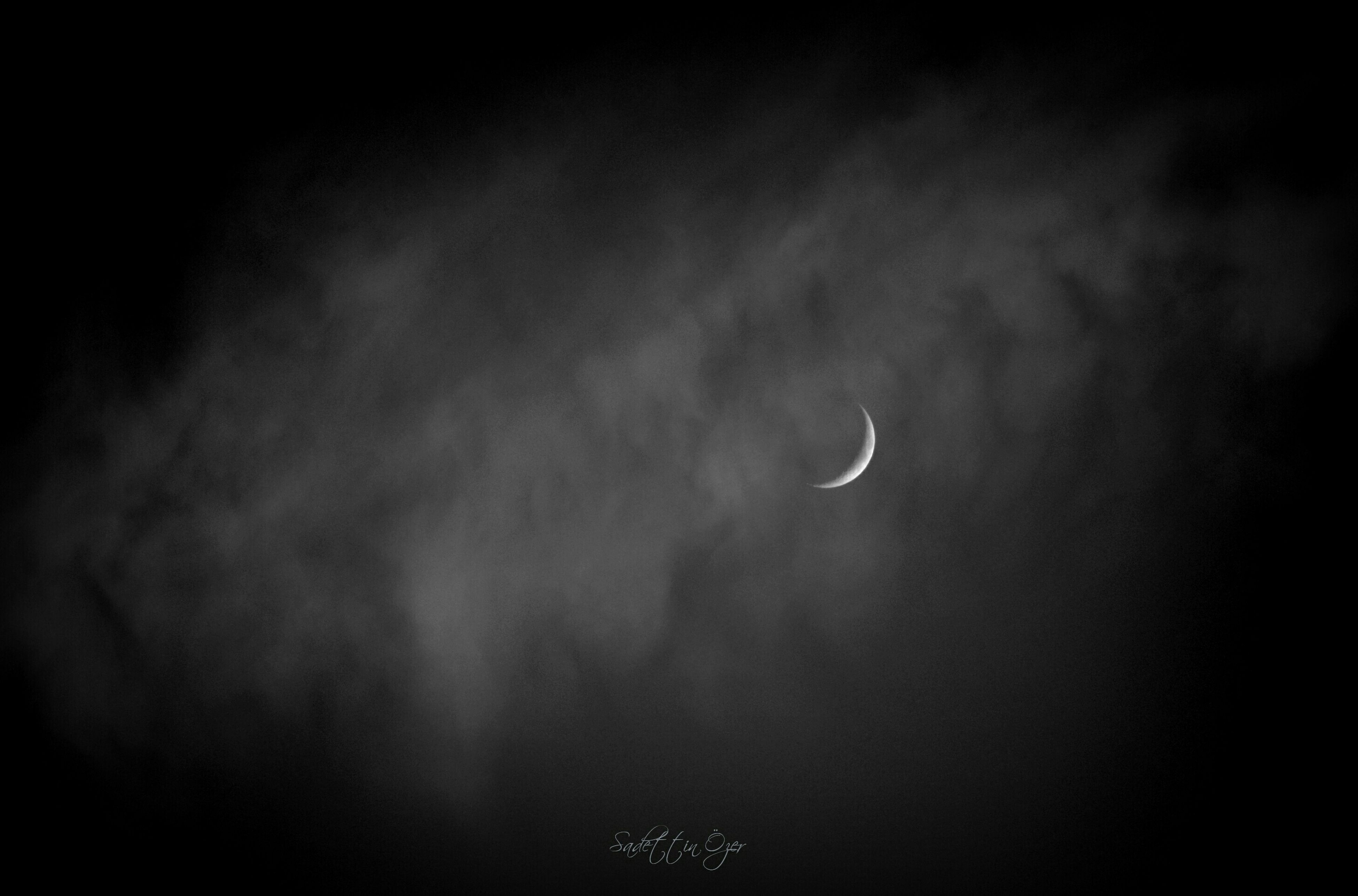 night, low angle view, moon, beauty in nature, sky, scenics, tranquility, tranquil scene, nature, copy space, astronomy, dark, weather, idyllic, sky only, majestic, dusk, no people, outdoors, cloud - sky