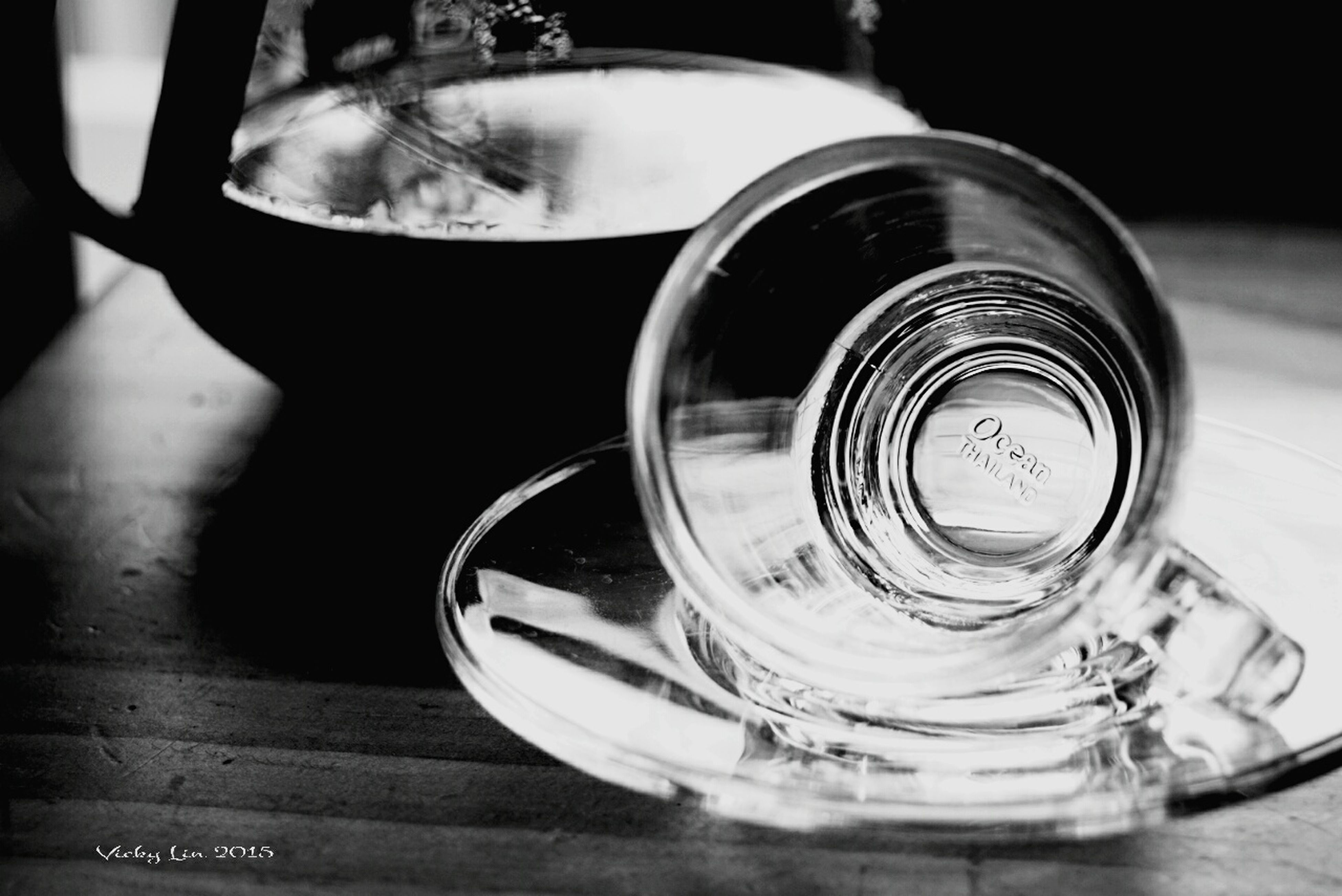 indoors, close-up, table, drink, refreshment, still life, focus on foreground, glass - material, reflection, drinking glass, transparent, water, no people, wineglass, high angle view, food and drink, glass, selective focus, freshness, shiny