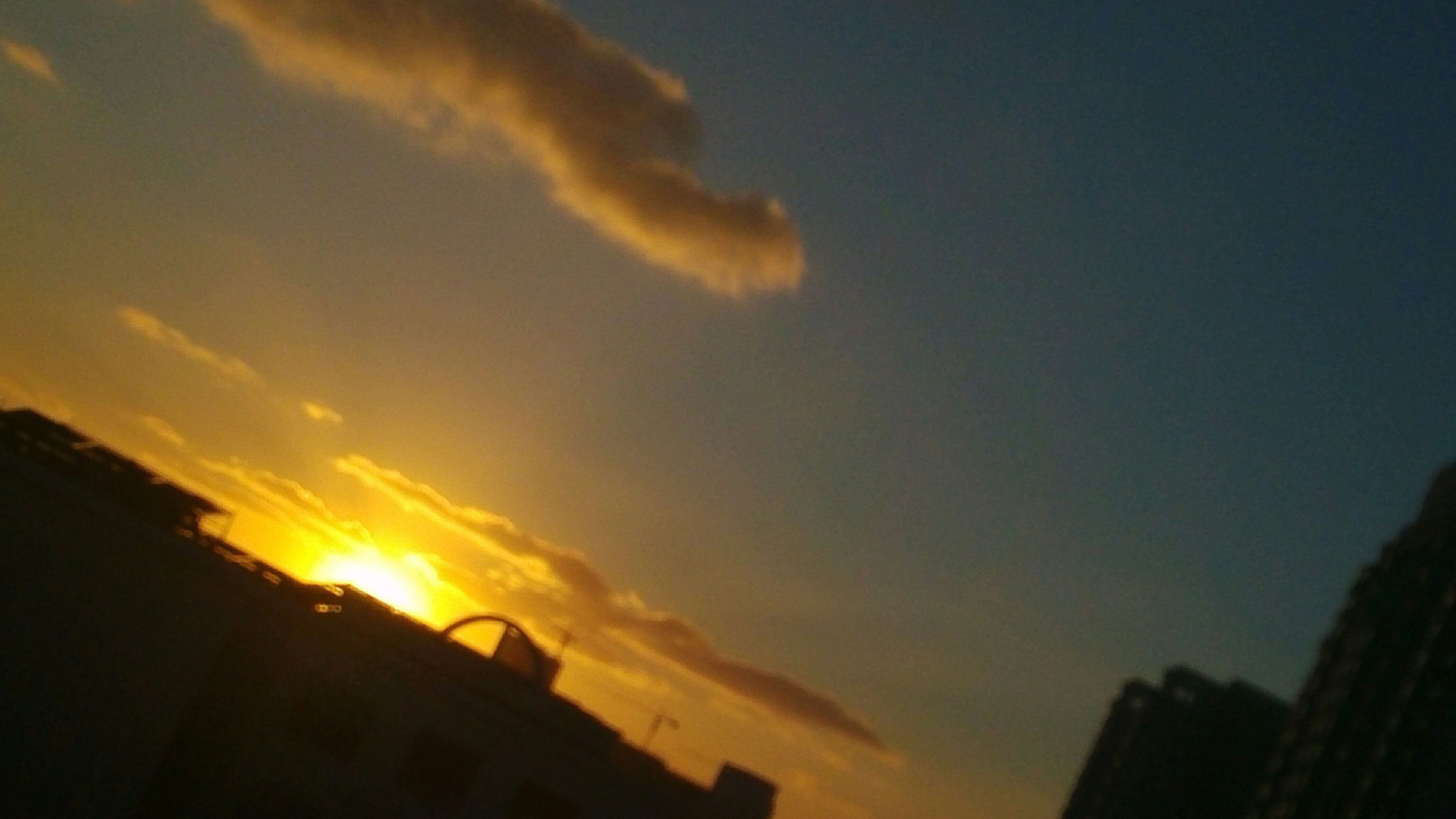 sunset, sky, silhouette, low angle view, cloud - sky, orange color, building exterior, built structure, architecture, beauty in nature, nature, cloud, scenics, outdoors, no people, sunlight, cloudy, dramatic sky, tranquility, dusk
