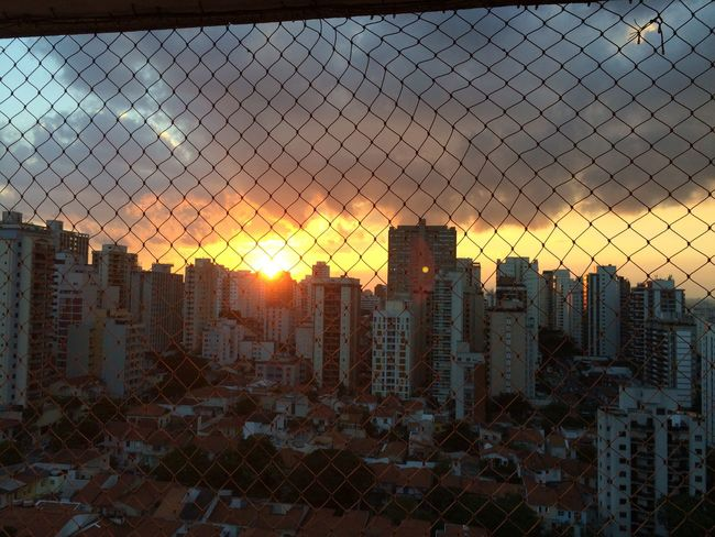 sao paulo BRAZIL 2016 Backgrounds Chainlink Fence City City Life Cityscape Cityscapes Cloud Cloud - Sky Development EyeEm Team Focus On Foreground Full Frame Modern Nature No People Orange Color Outdoors Residential District Sky Sun Sunlight Sunset Urban Skyline
